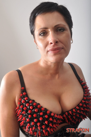short haired femdom posing