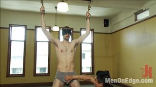 bondaged slim guy suffering